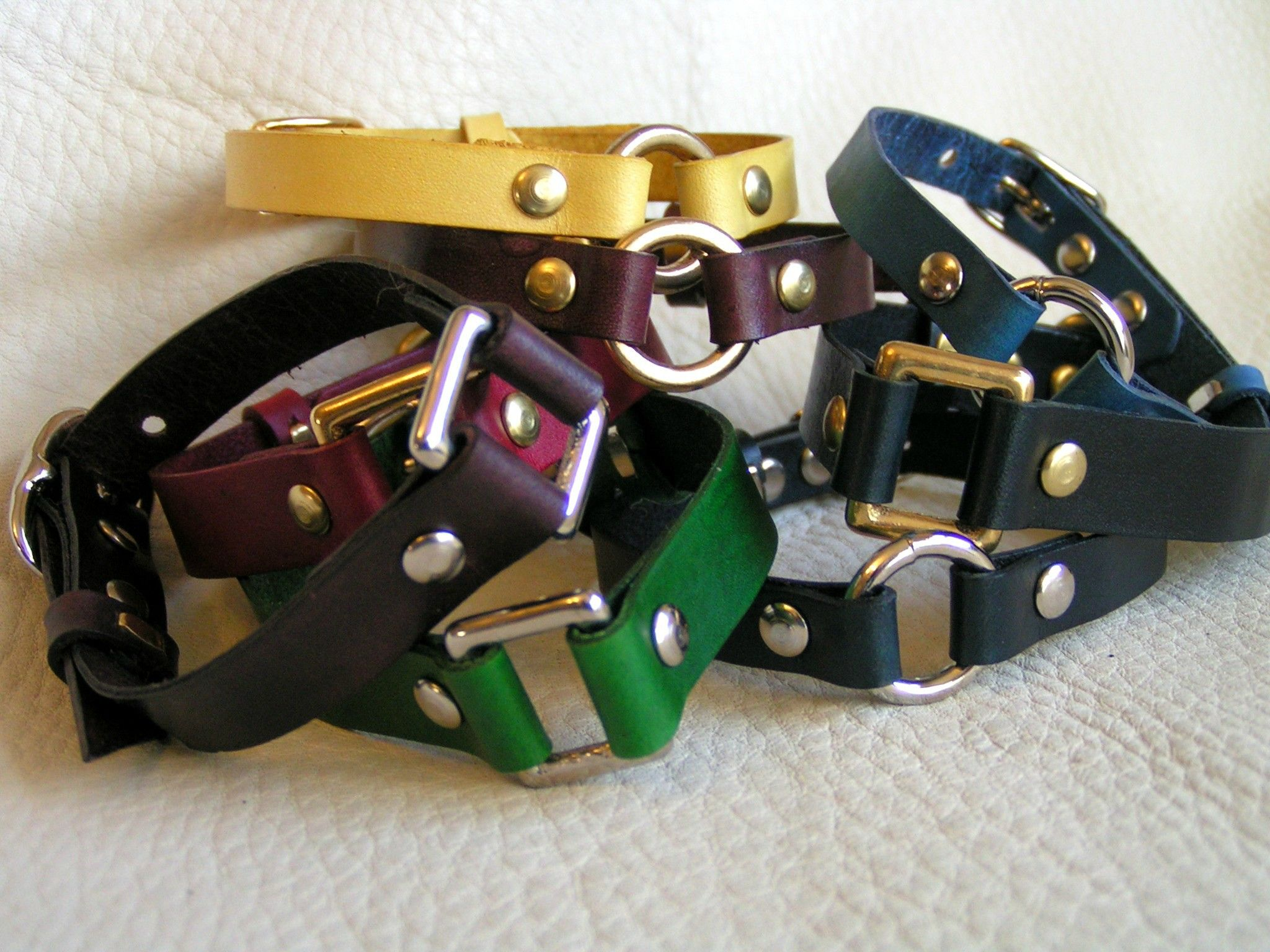 Harness cuffs, leather straps and various bits of hardware combined into a cuff.