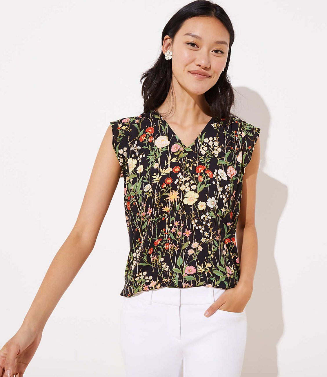 bd7b3793ac49c Fluttery cap sleeves frame this fluid shell in pretty. V-neck. Cap sleeves