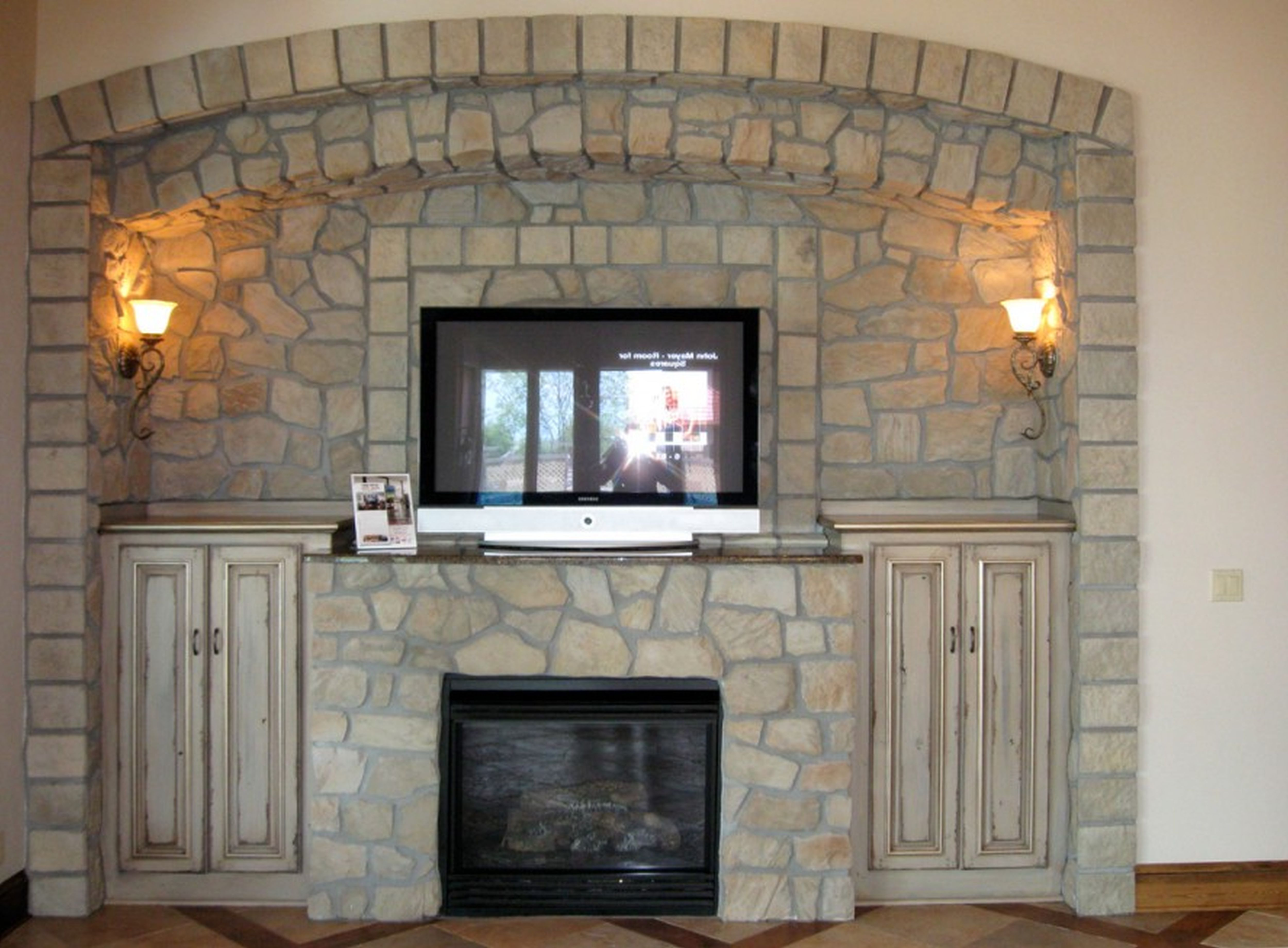 Beautiful Tuscany Interior Stone Veneer Fireplace And TV