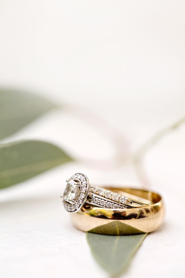Stunning halo engagement ring and gold wedding band: http://www.stylemepretty.com/alabama-weddings/2015/11/11/elegant-blush-southern-military-wedding-in-alabama/ | Photography: Glass Jar Photography - http://glassjarphotography.com/index2.php#!/HOME