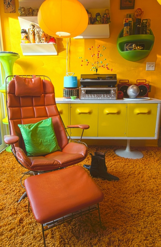 Awesome Bright Yellows, Oranges And Greens, Bold Shapes And Patterns And Shag  Carpet Create This Retro Living Room.