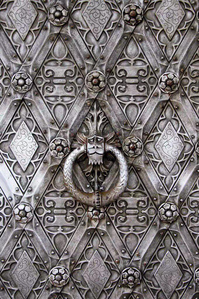 Silver intricate door details.