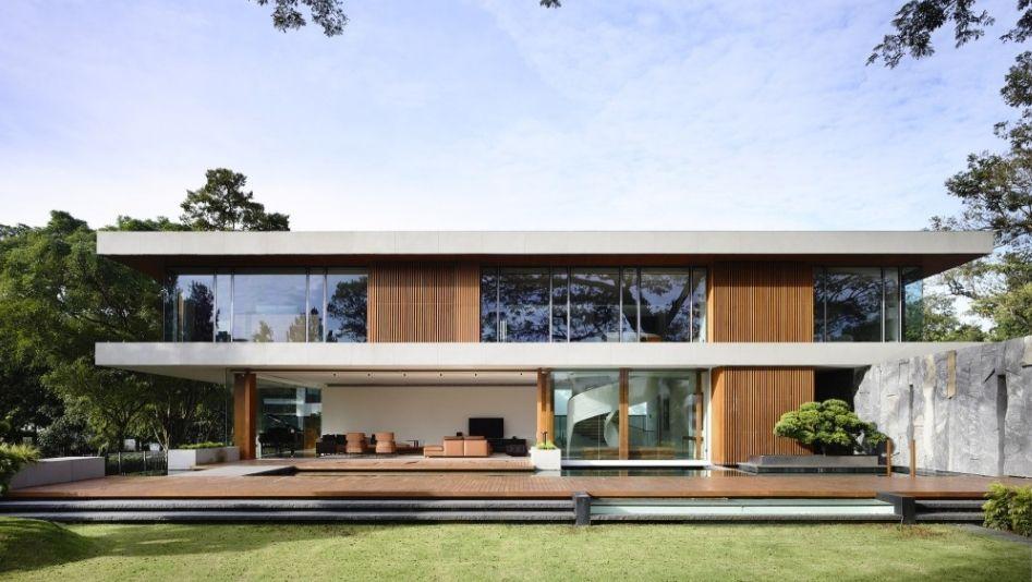 Savant mélange de bois, béton et granit pour cette maison ...