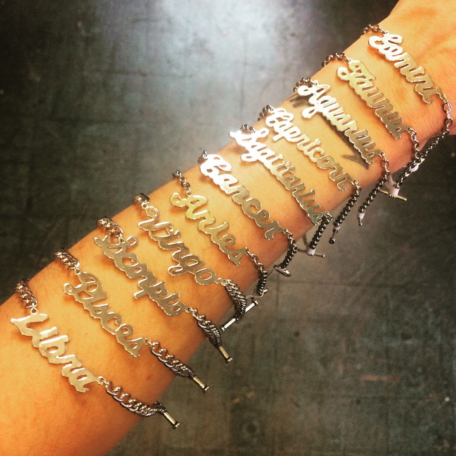 Restocked these #handmade silver #zodiac script #bracelets. Sorry, #leo is SOLD OUT. All the rest available in store and online. Link in bio to shop. ✨ . #heytiger #shopheytiger #handmadeshop #buyhandmade #supporthandmade #hellostranger #etsy #etsyseller #etsyshop #etsyhandmade #handmadejewelry #handmadebracelet #aries #taurus #gemini #cancer #virgo #libra #scorpio #sagittarius #capricorn #aquarius #pisces #astrology #whatsyoursign