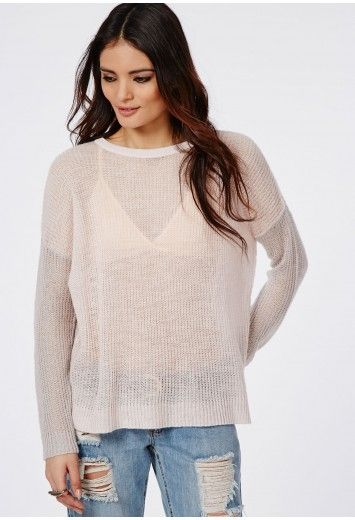 This feather light brushed knit crew neck jumper is fresh style for the transitional season that works great for layering. With a pink front, grey back and sleeves and ribbed collar this modern piece with add rad vibes to any look. Style wi...