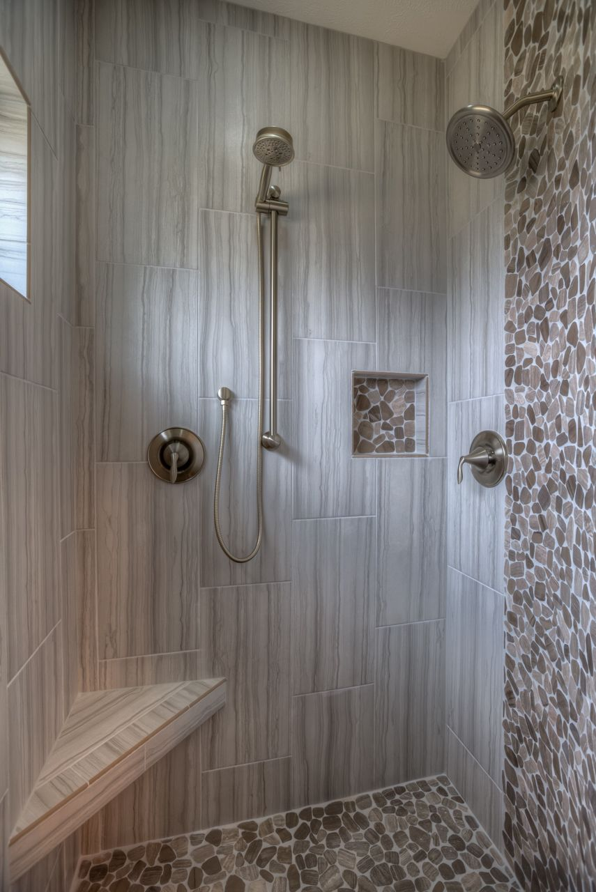 Master shower with seat and shelf. Pebble tile floor and accent ...