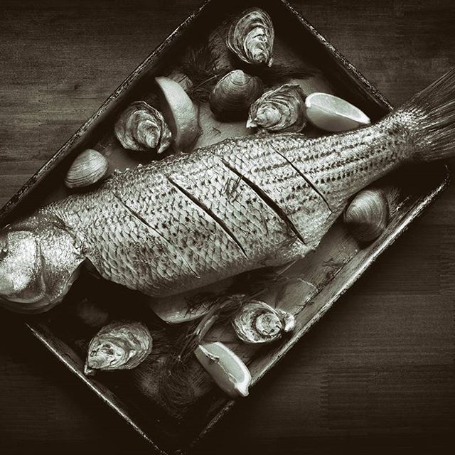 Our fish is so good that even in black and white it looks delicious!   #foodcivilization #colorsandflavors #thetravelerslife #foodphotography #wheredoyoueat #pbstation #freshfood