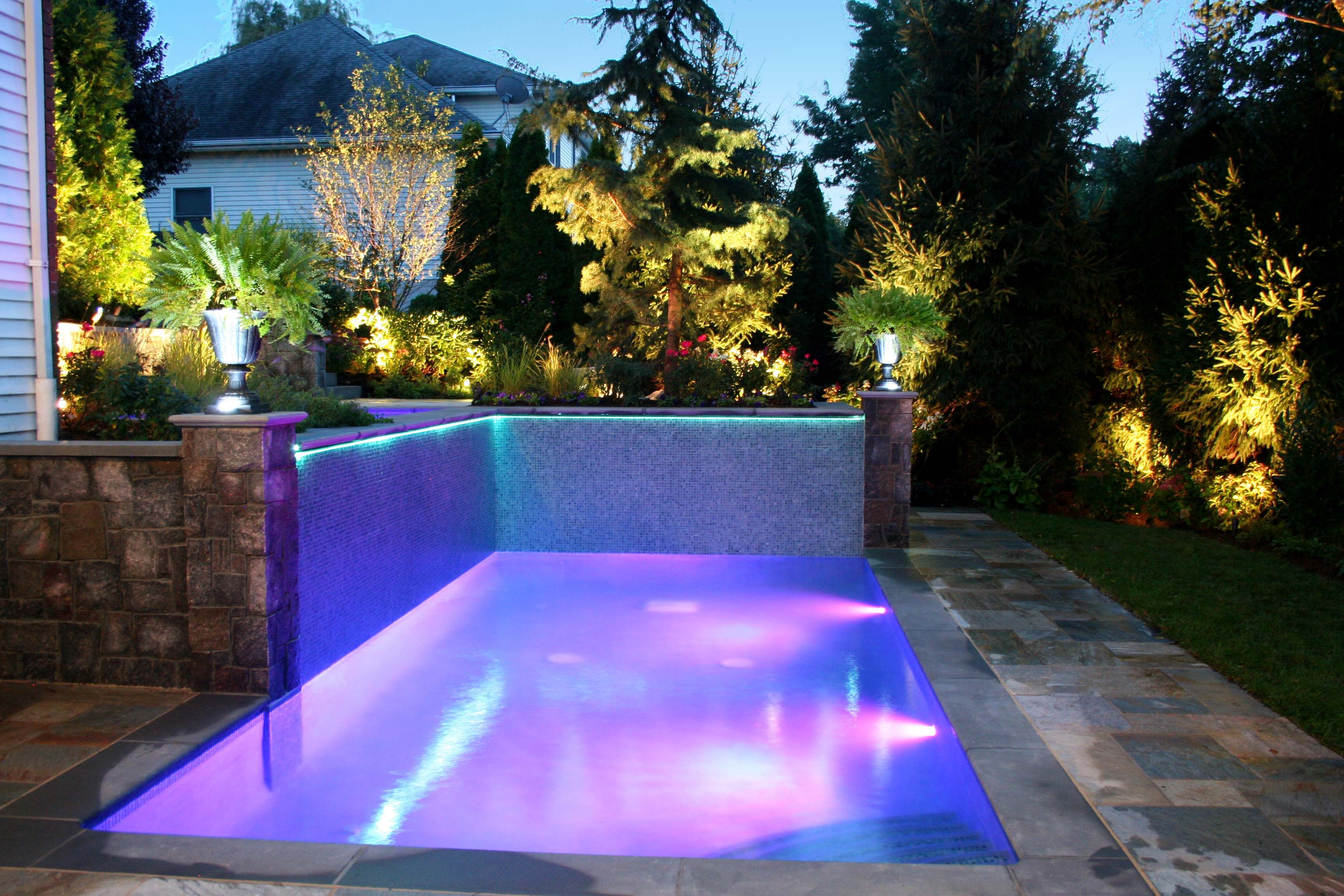 Cipriano custom swimming pools landscaping illuminated for Custom inground swimming pools