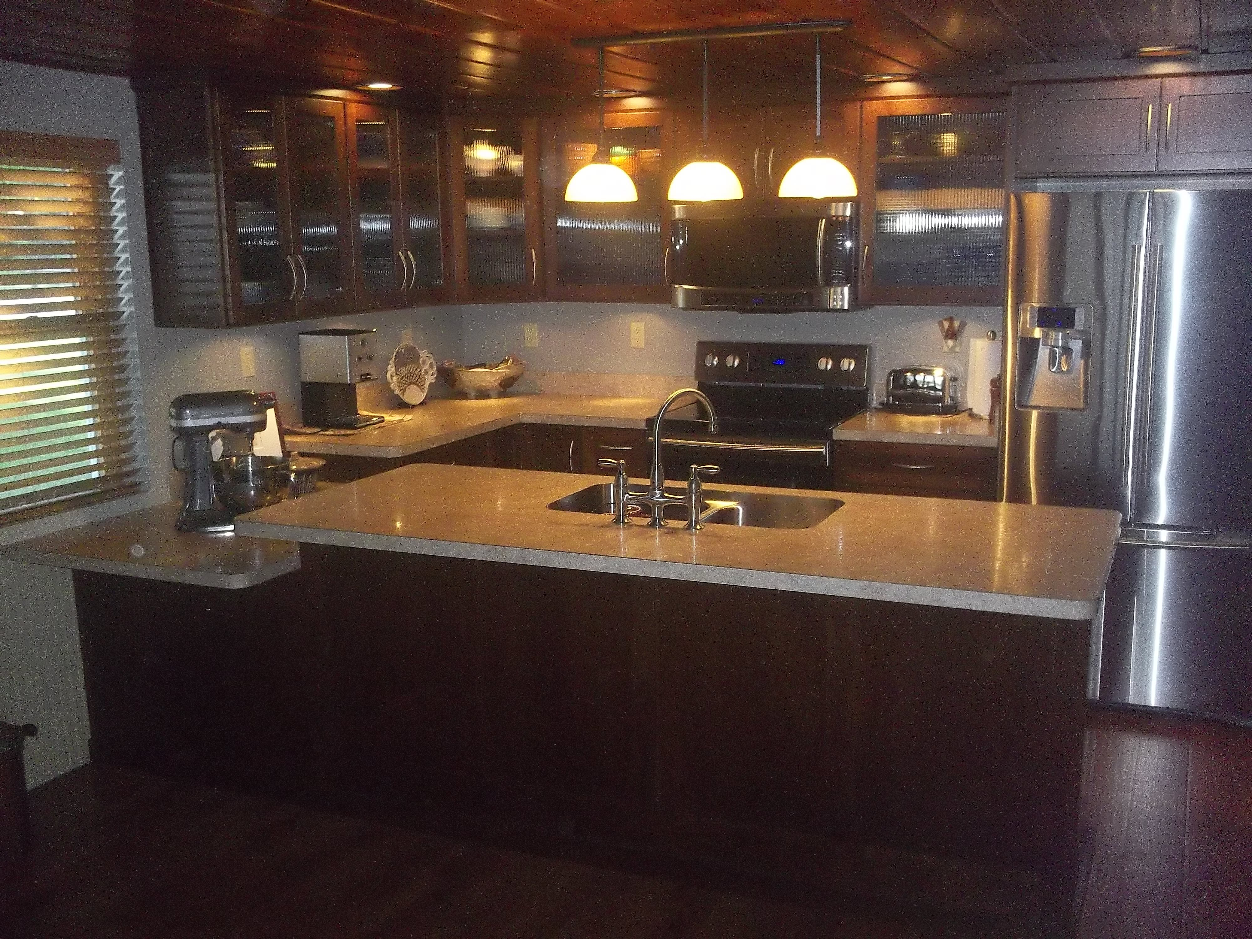 Countertops Definition Dark Maple Cabinetry With Reeded Glass And A Stainless