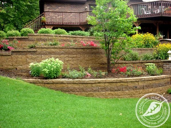 Tiered Multi Level Retaining Walls With An Accent Of Contrasting Colored Block Create A Stunning Way To Soften Steep Slope