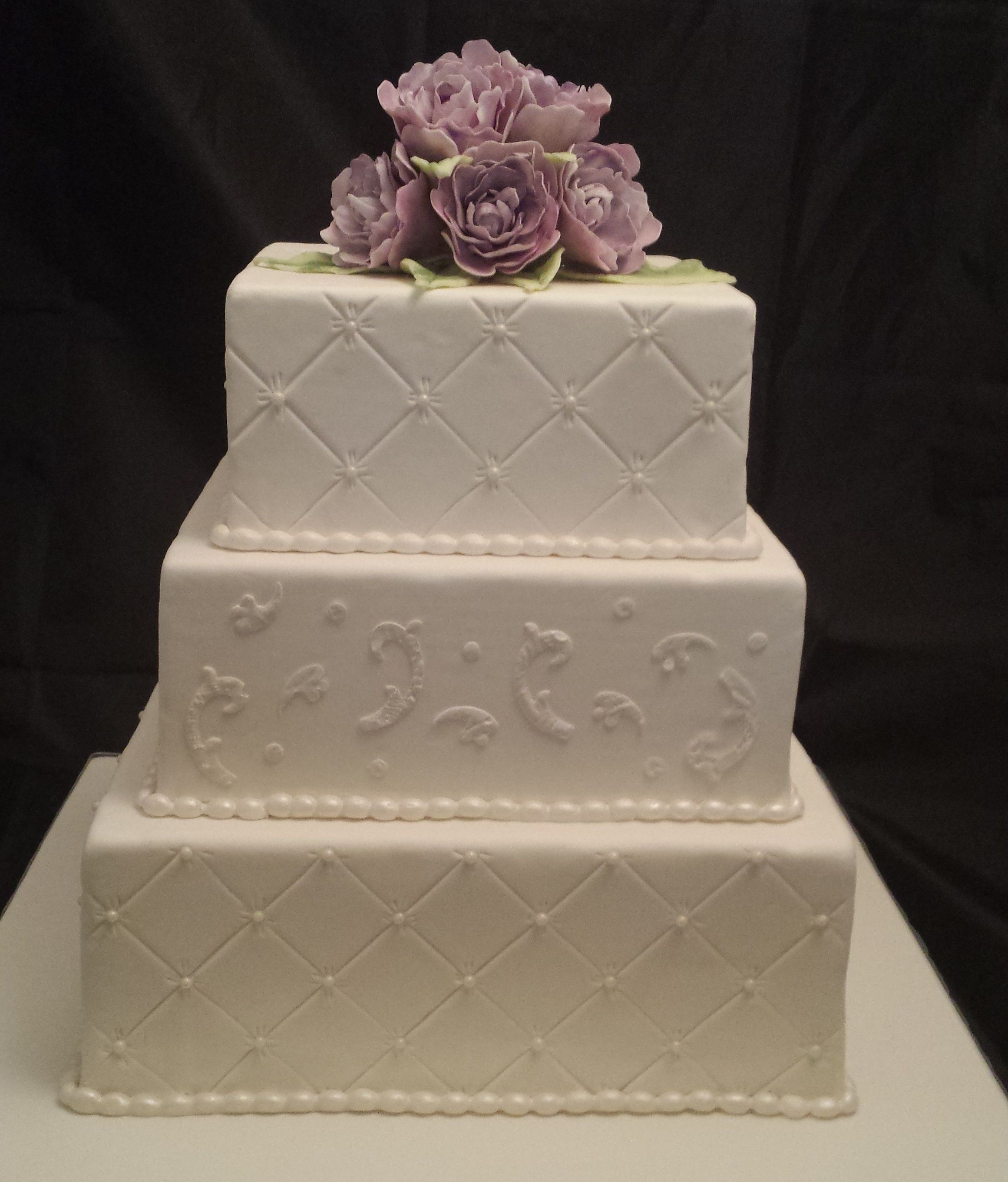 3-tier square wedding cake with quilting around 2 of the tiers ...