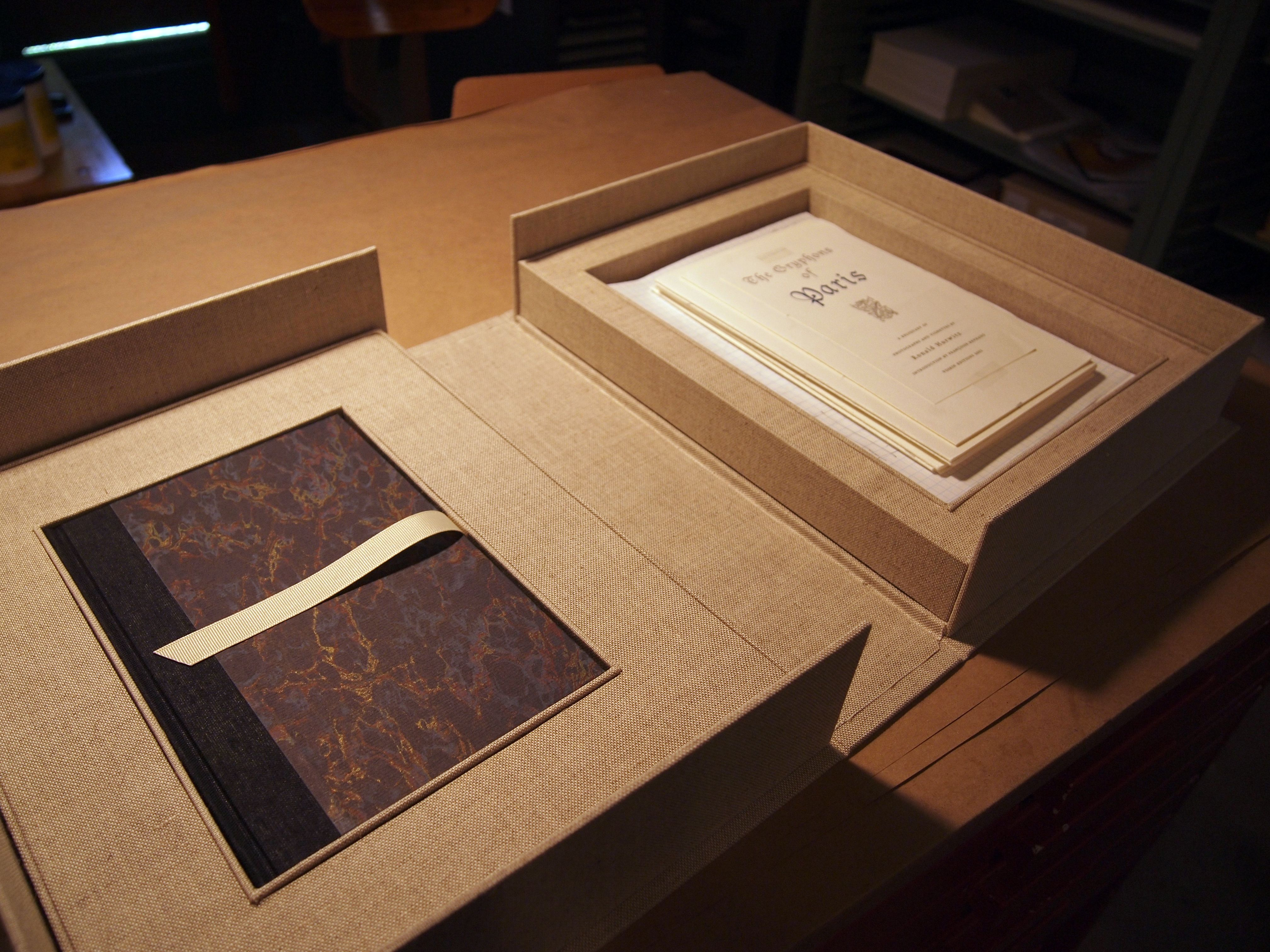Two book clamshell in this case folio and ephemera for Clamshell casing