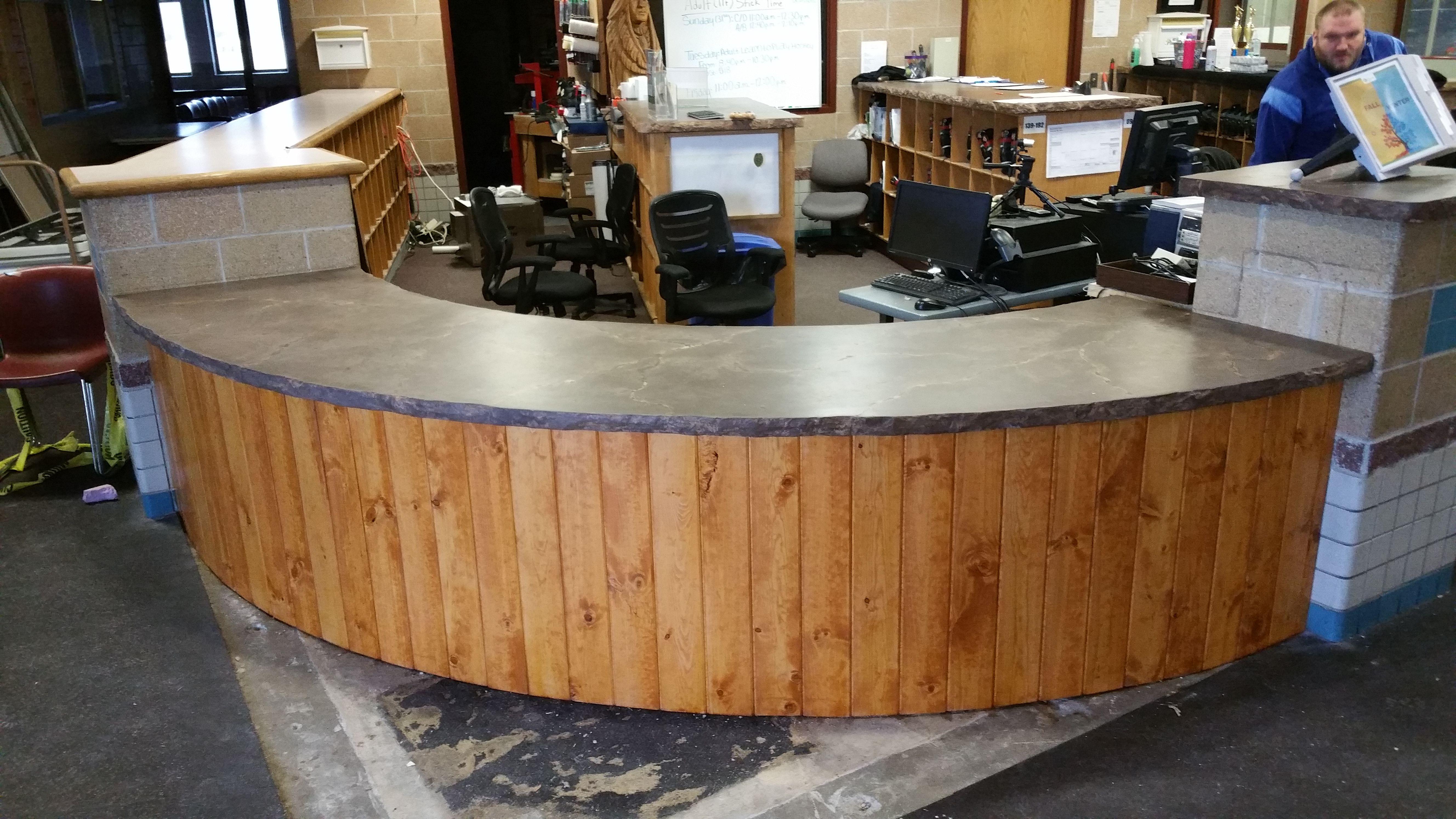 Concrete countertop on reception desk   Concrete Countertops ...