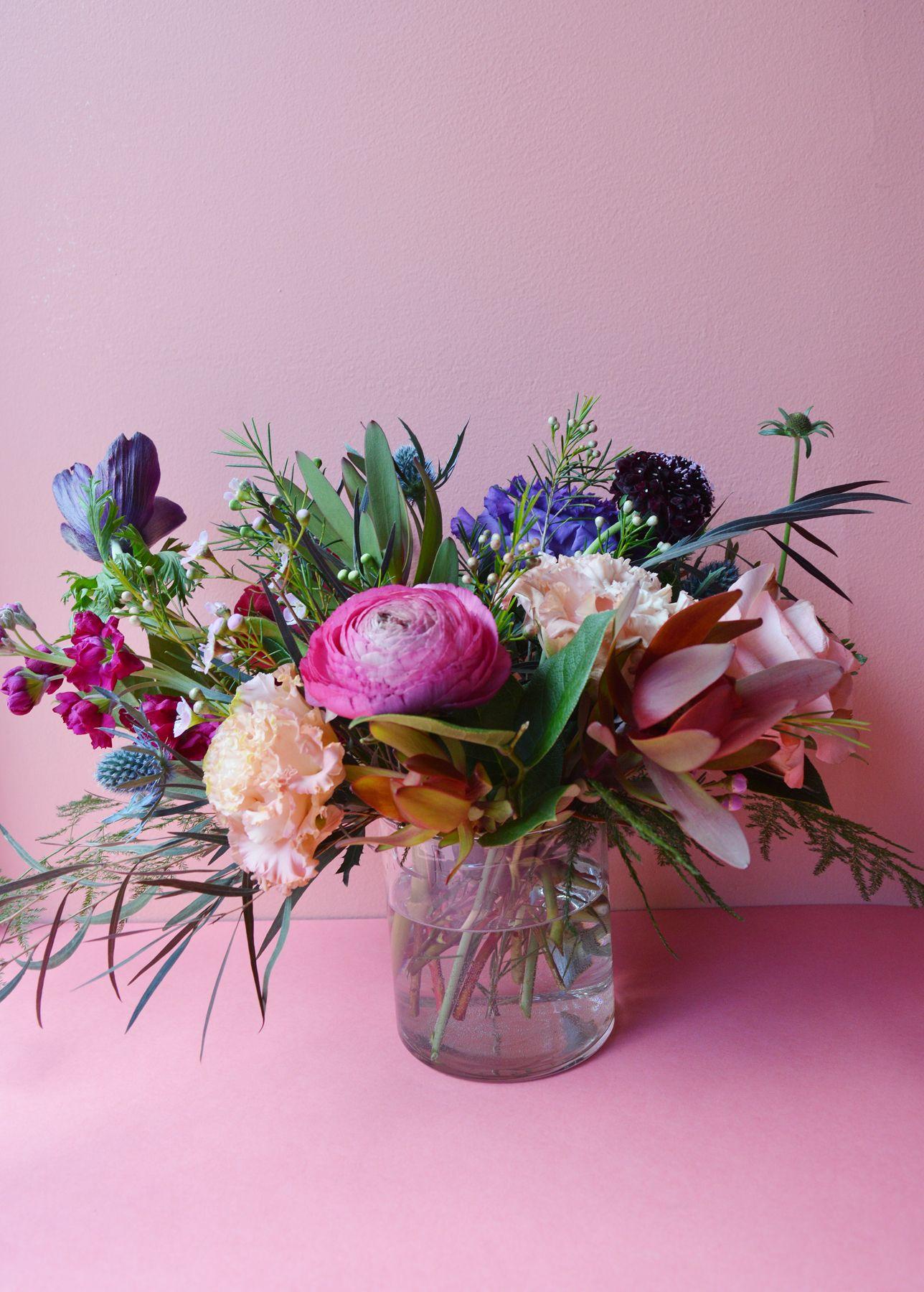 Beautiful table arrangement featuring ranunculus thistles