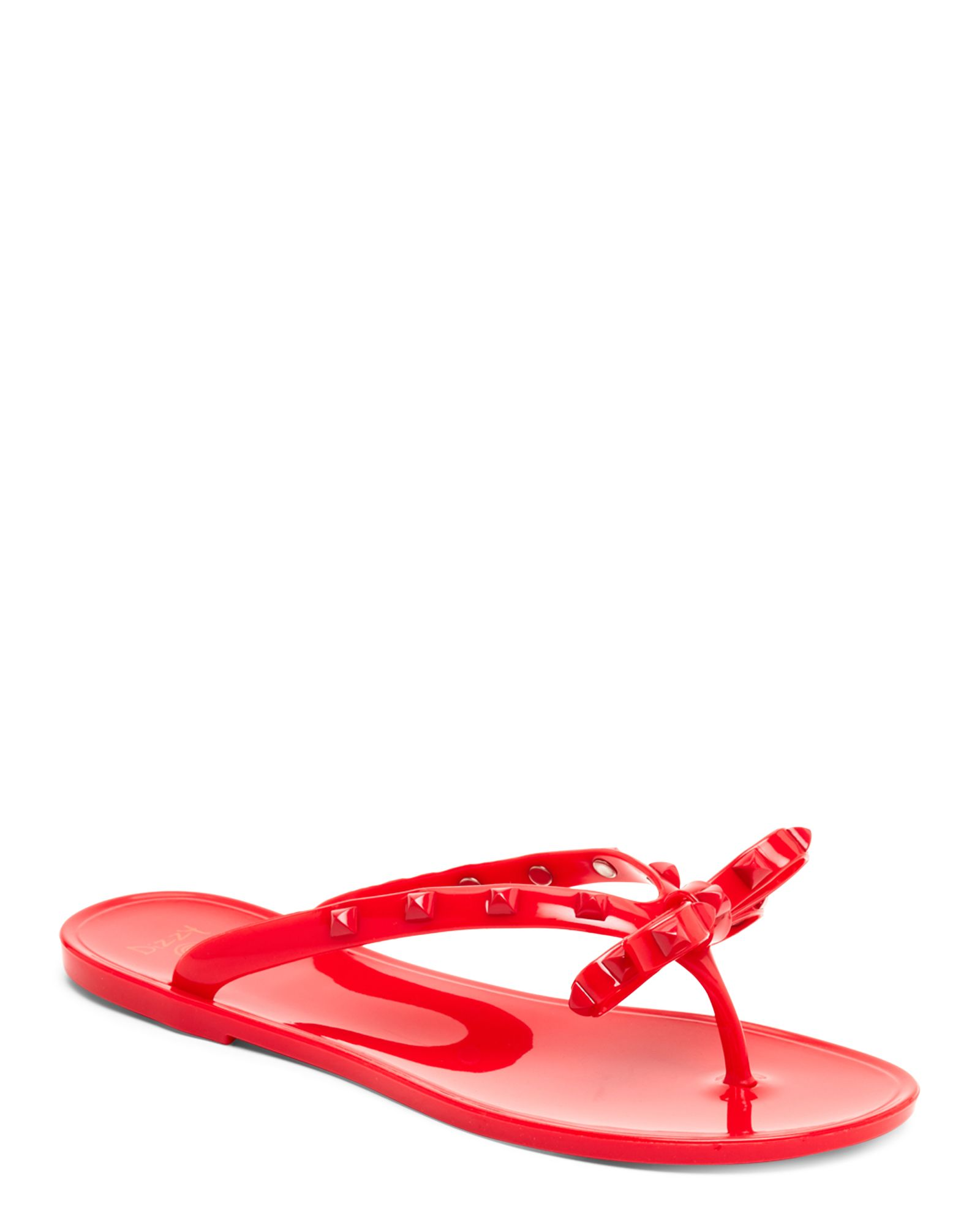 89ca9c5c0fda Dizzy Rivet Studded Jelly Flip-Flops. Dizzy Studded Jelly Flip Flops Bow  Sandals
