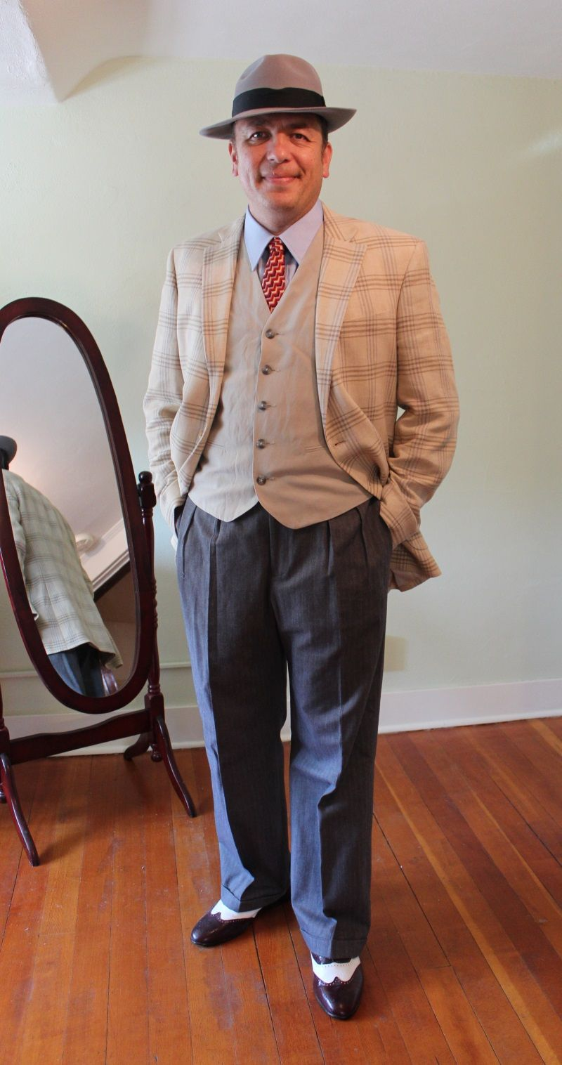 88a43293496 1940s men's fashion: sports coat over vest, wige leg trousers, wingtips and  fedora