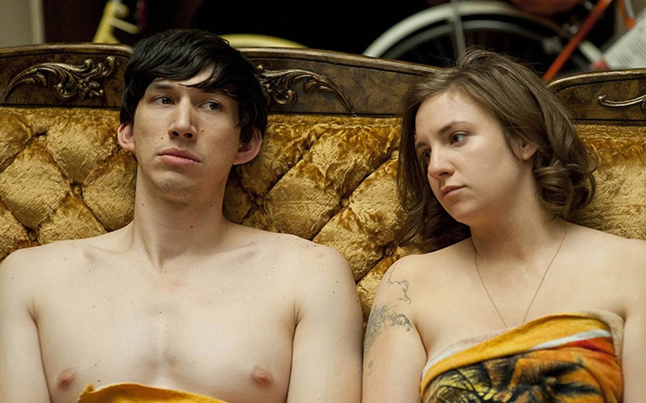 Adam Driver, shirtless, and Lena Dunham on a gold couch in Girls