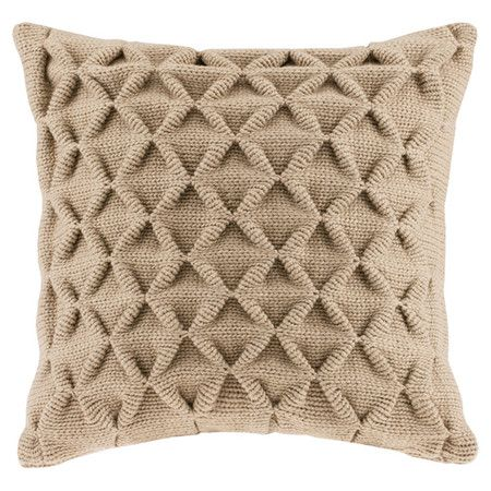 Showcasing a lovely waffle-knit design, this throw pillow adds textured appeal to your sofa or loveseat. Try mixing in a colorful throw for added flair....