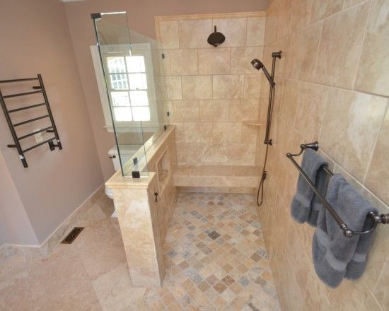 Roll in shower. Seat on one end. Seat matches the rest of the shower ...