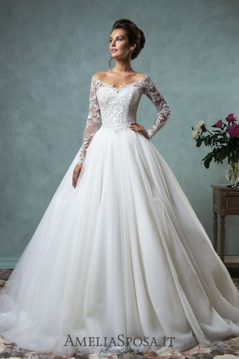 Long sleeve ballgown Wedding dress Nova - AmeliaSposa.    A classic silhouette that spreads femininity and generousness. A light skirt makes the whole look luxury and royal. A little bit soft sleeves and a transparent back embroidered by lace will emphasize your sensuality and make a fiancé's heart beat thick.