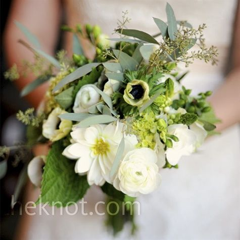 "Love it. ""Beautiful and not at all fussy,"" is how the bride describes her bouquet of ranunculus combined with eucalyptus and greenery."