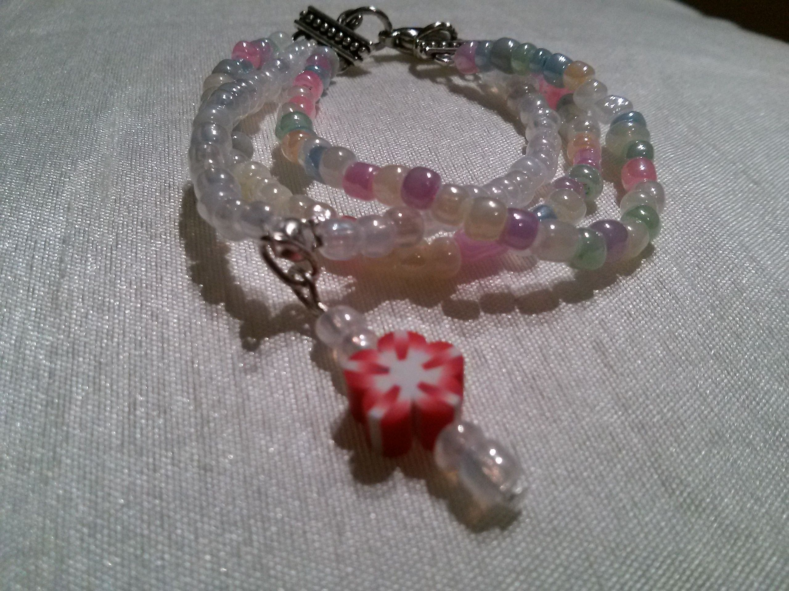 Seed bead bracelets for girls with a flower pendantfun and easy