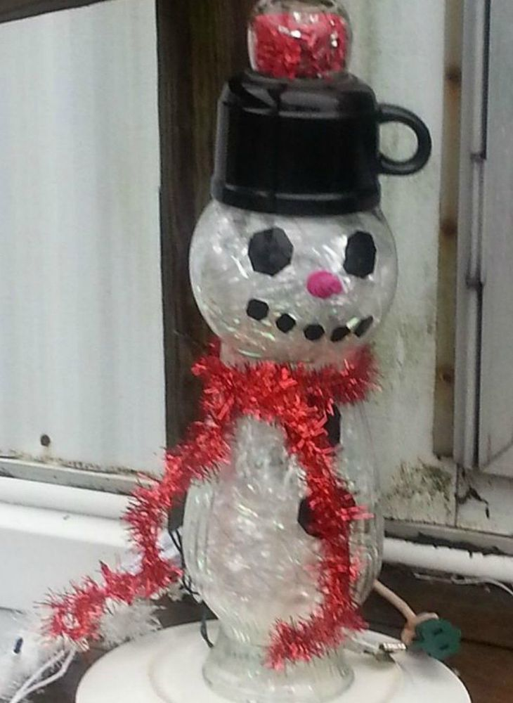 s 13 surprising ways to make a snowman for your porch, Build a glass totem out of repurposed materia