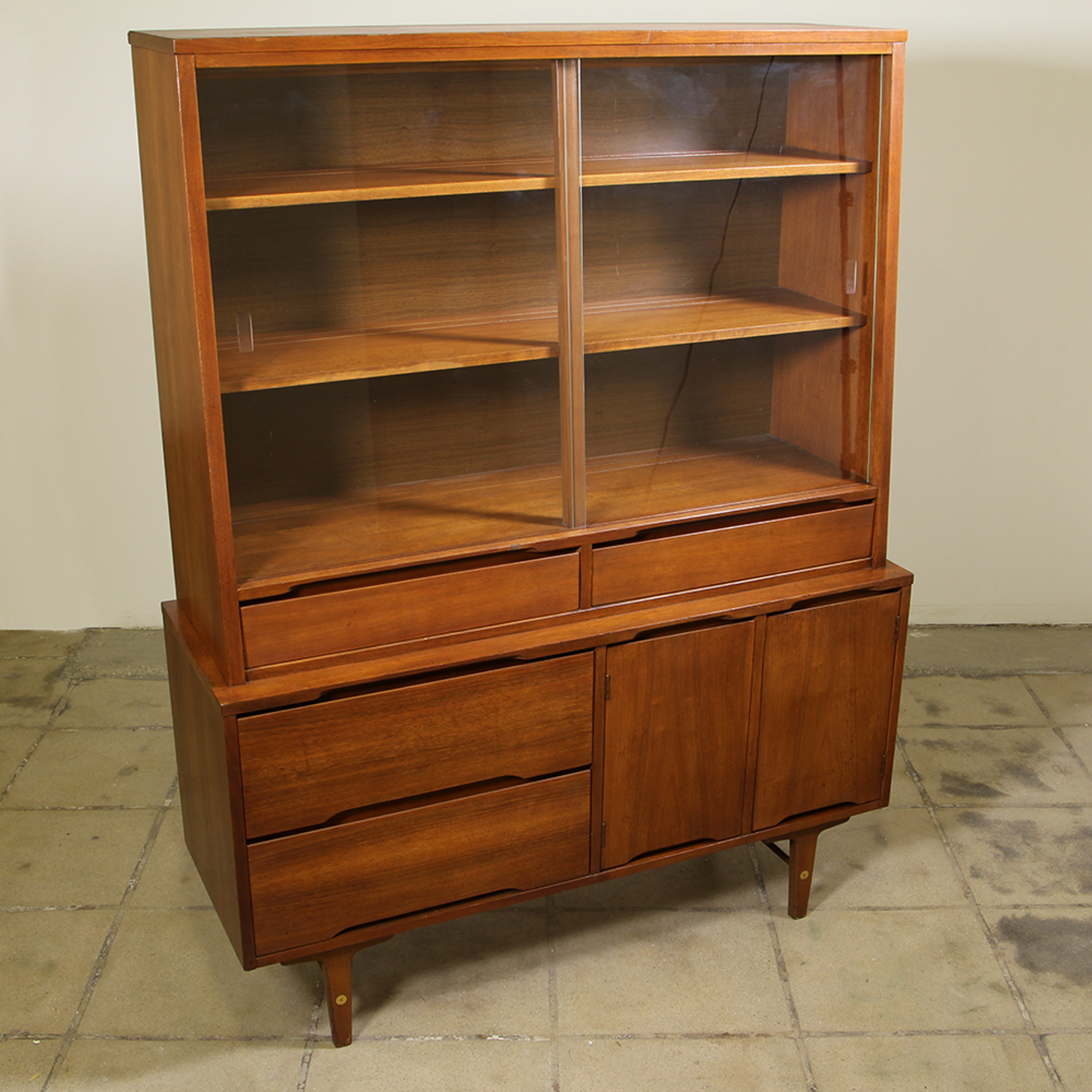 this mid century modern china cabinet is featured in a solid wood with gorgeous glossy teak