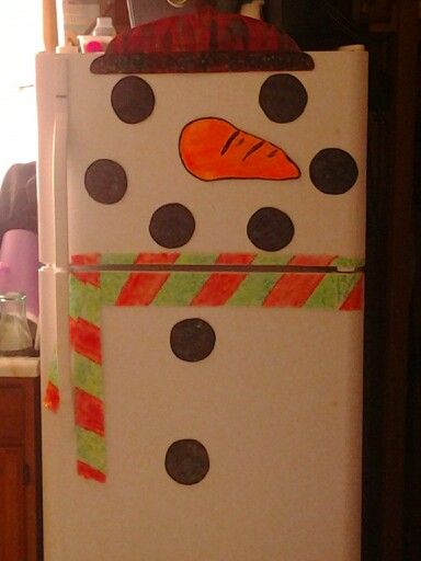 Snowman fridge thanks to Pinterest  I got this  idea. Best  part is it glows. It was quite  a surprise. That was totally unexpected.