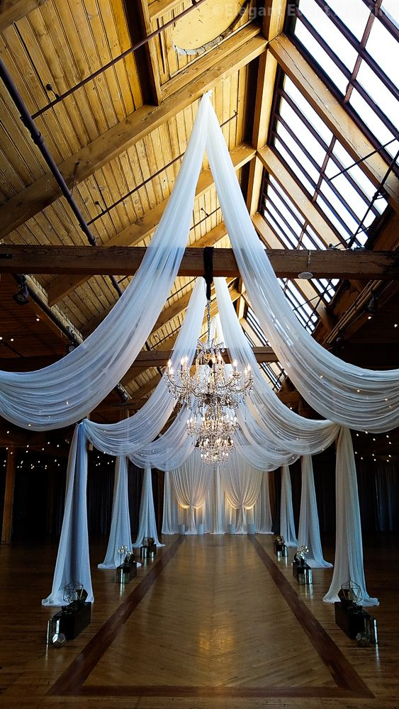 An Absolutely Stunning Ceiling Drape Design With Hanging Crystal Chandeliers At Bridgeport Art Center In 2020 Wedding Ceiling Wedding Decorations Ceiling Draping