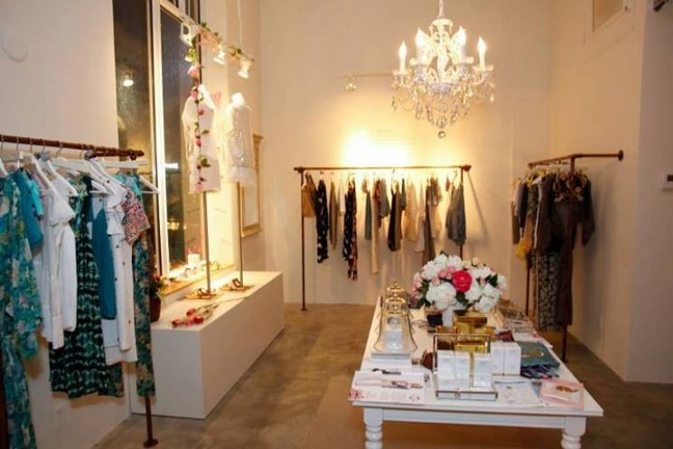 There is a stunning new retail player nestled among the shops in Miami Beach . Roses & Dreams , located at 220 10th Street, offers Miami shoppers