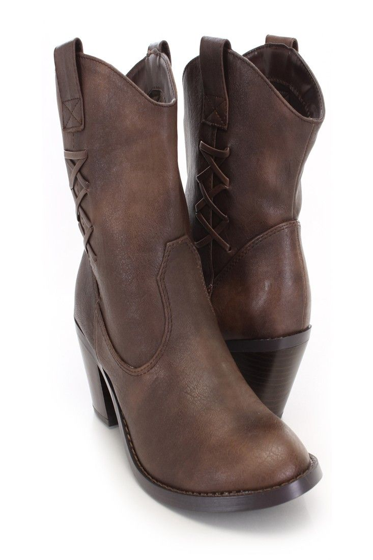 Be comfy yet stylish this season with these fashionable cowboy style booties! They will go perfect with your favorite dress or skinnies! Make sure you add these to your closet, it definitely is a must have! The features include a faux leather upper with a round closed toe, stitched detailing, cross strappy detailing, slip on design, smooth lining, and cushioned footbed. Approximately 2 1/2 inch heels.