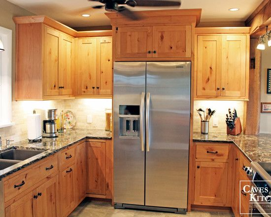 Awesome Rustic Kitchen With Knotty Pine Cabinets Also Stainless Refrigerator Also Black