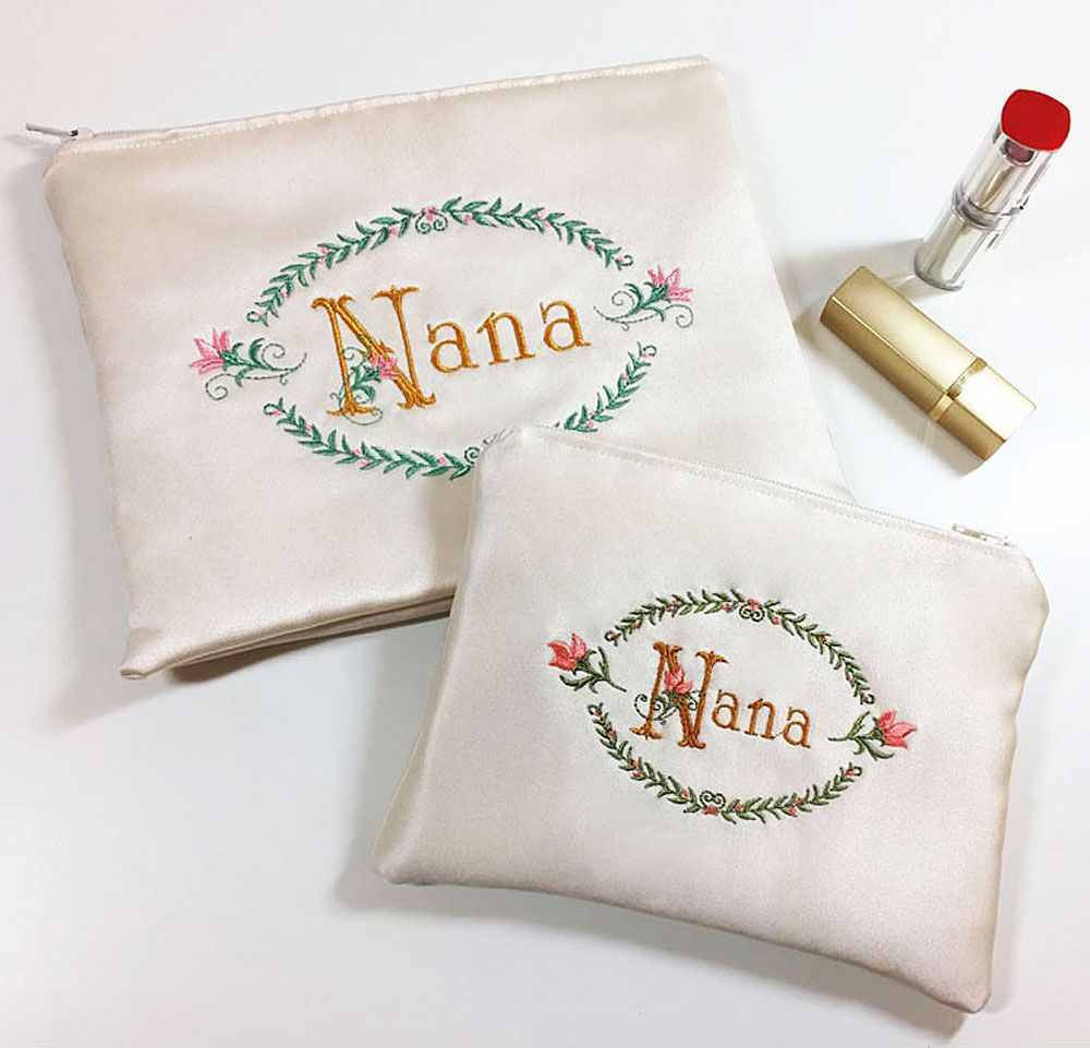 Custom Monogram Satin Bag in White or Ivory. Heirloom Embroidered Cosmetic, Jewelry, Travel Accessory Purse. Evening Bag for Wife, Sister, Best Friend. The perfect bridesmaid gift. CUSTOM DESIGNED & embroidered monogram art with original design.  #bridesmaid   SteadyThreadsStudio.etsy.com or always available at SteadyThreadsStudio.com