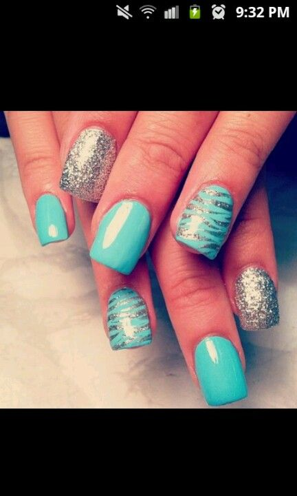 Zebra print wit silver and a sky blue nail color ..!!!   Nails!!<3 ...
