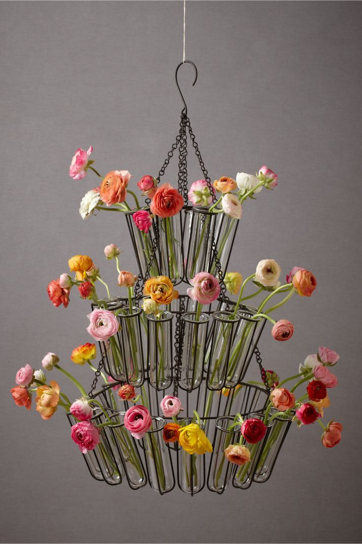 spring wedding decor anthropology chandelier with bright wedding flowers
