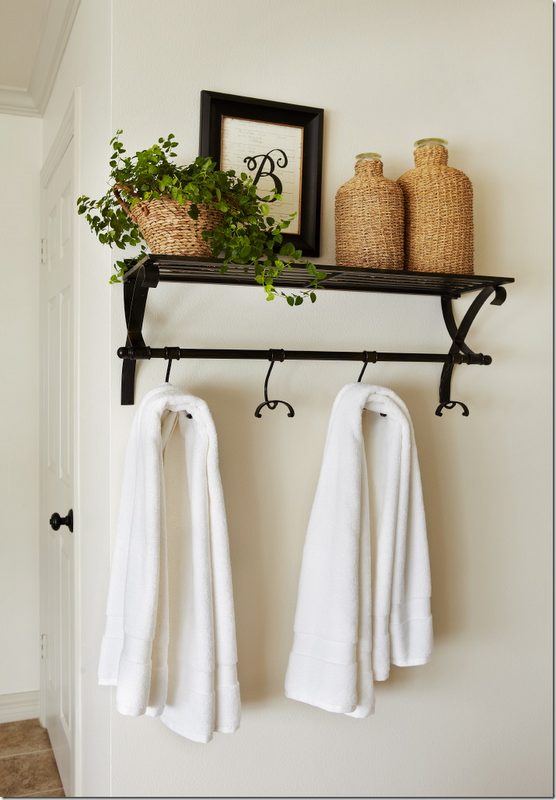 good shelf wouldnt do the wicker but i love it for towels and bathrobe maybe a couple of glass jars on top