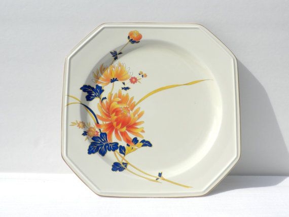 This is an octagon shaped serving dish, or platter by Mikasa Continental Ivory, Japan. It has a vibrant orange and cobalt blue floral pattern