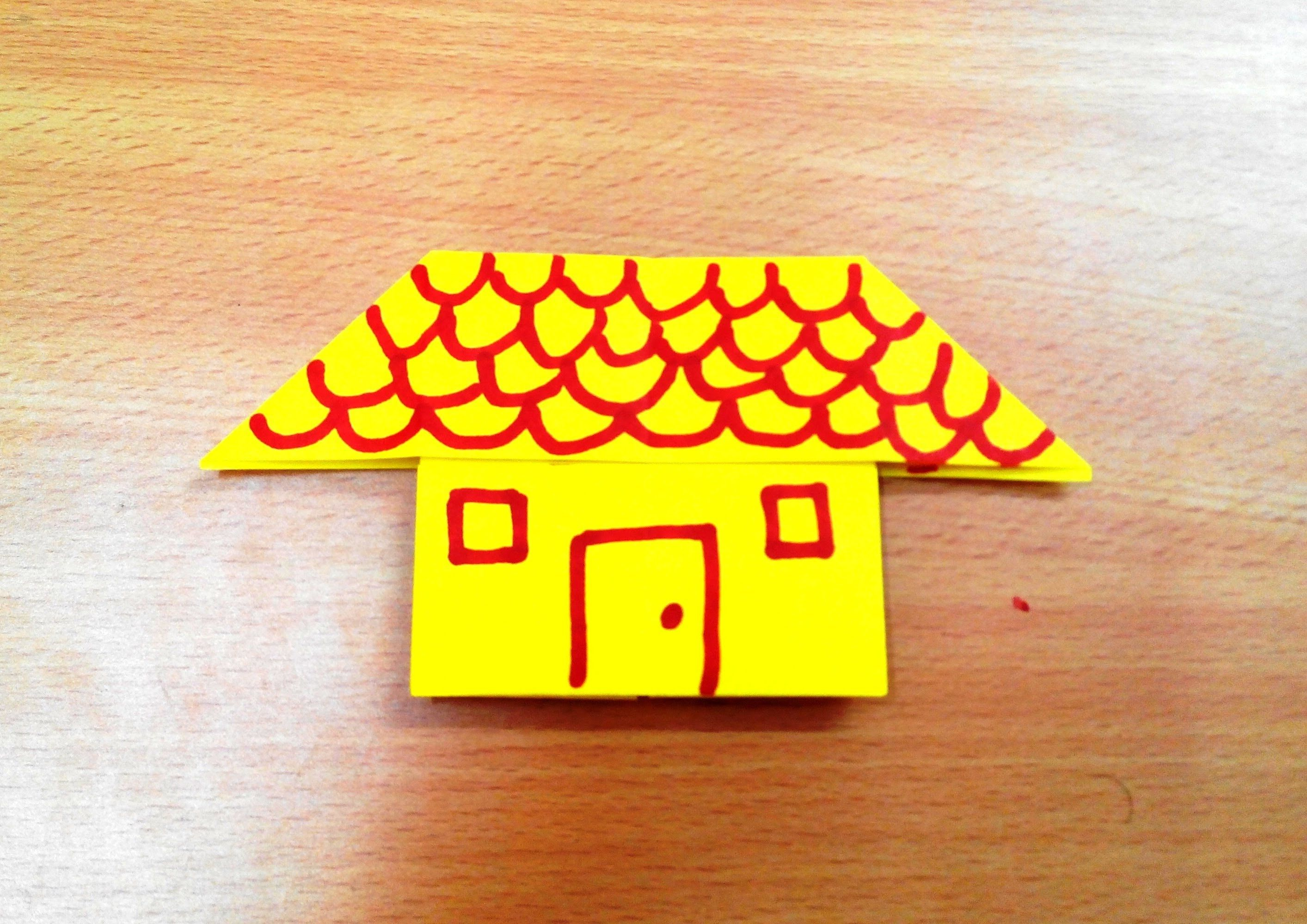 Learn how to make an origami paper house step by step