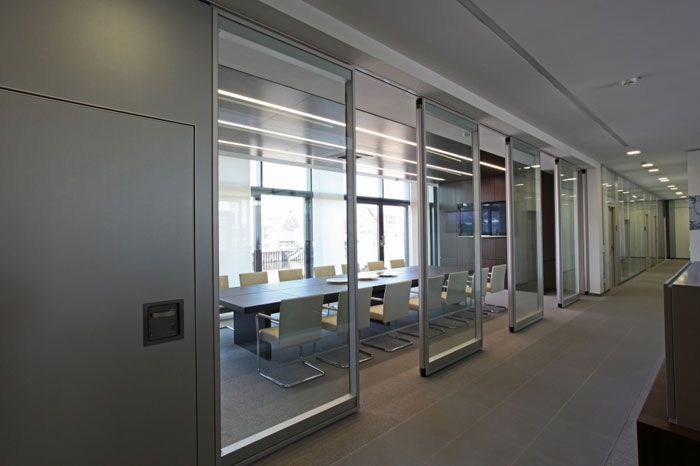 Open and light with glass sliding doors meeting room for Full wall sliding glass doors