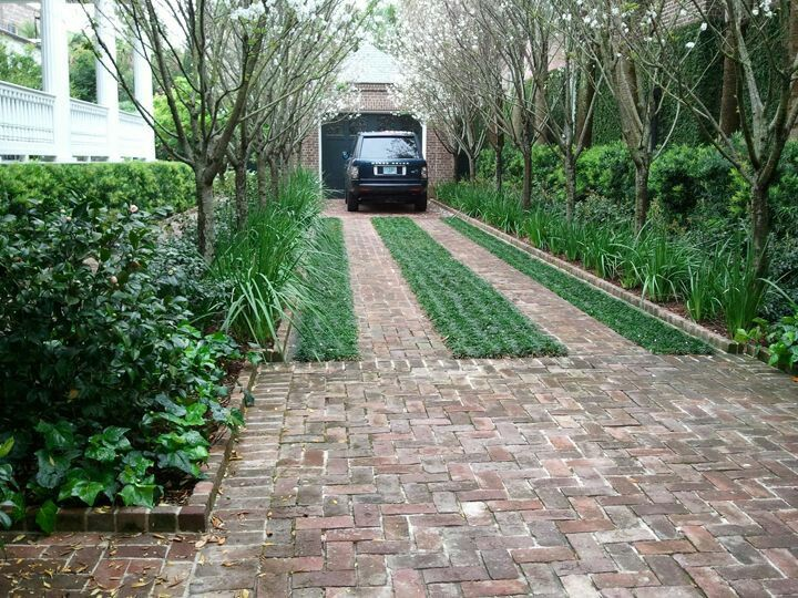 Brick Driveway Only Two Thin Rows For The Tires With