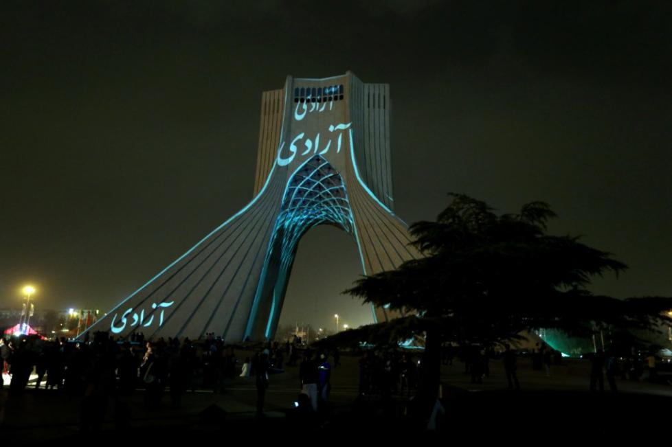 German artist Philipp (videogeist.com) painted landmark Azadi tower in Tehran with light October 3, 0215 (AFP photo). Light installation