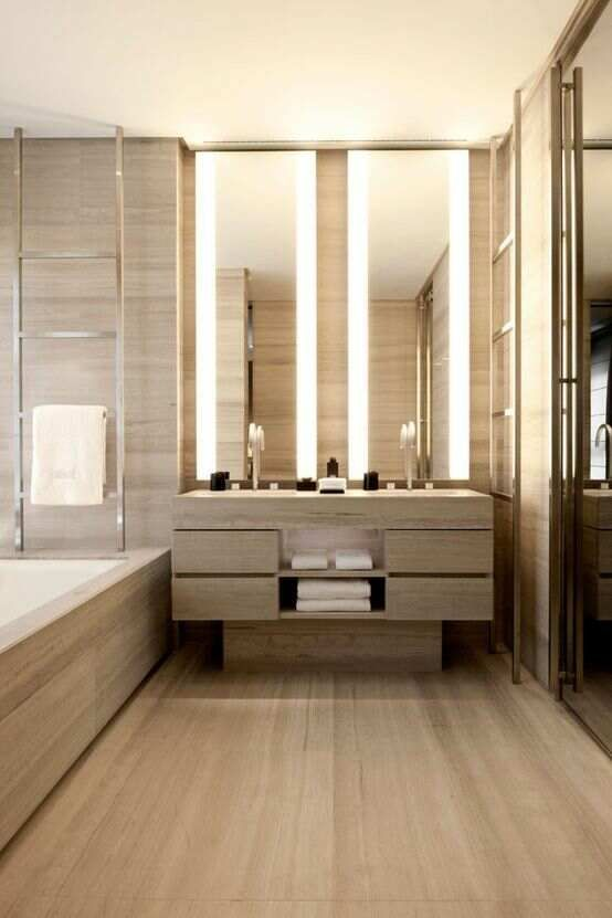 Interior design modern bathroom beige tan marble floor and wall tiles double vanity and bath tub