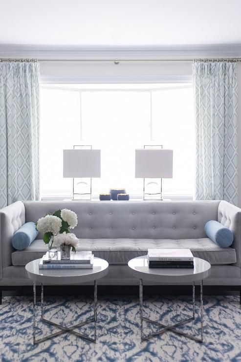 Best Blue And Gray Living Room Features A Gray Tufted High Back 400 x 300