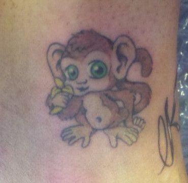 Baby monkey with banana tattoo design baby monkey for Baby monkey tattoos