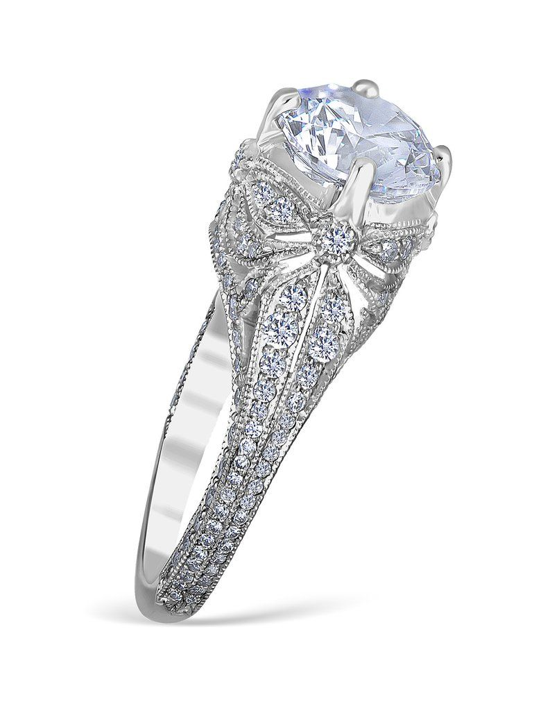 Whitehouse Brothers pave' especial engagement ring mounting with 86 handset diamonds weighing 0.85 carat total weight.  You can expect the best from this excep