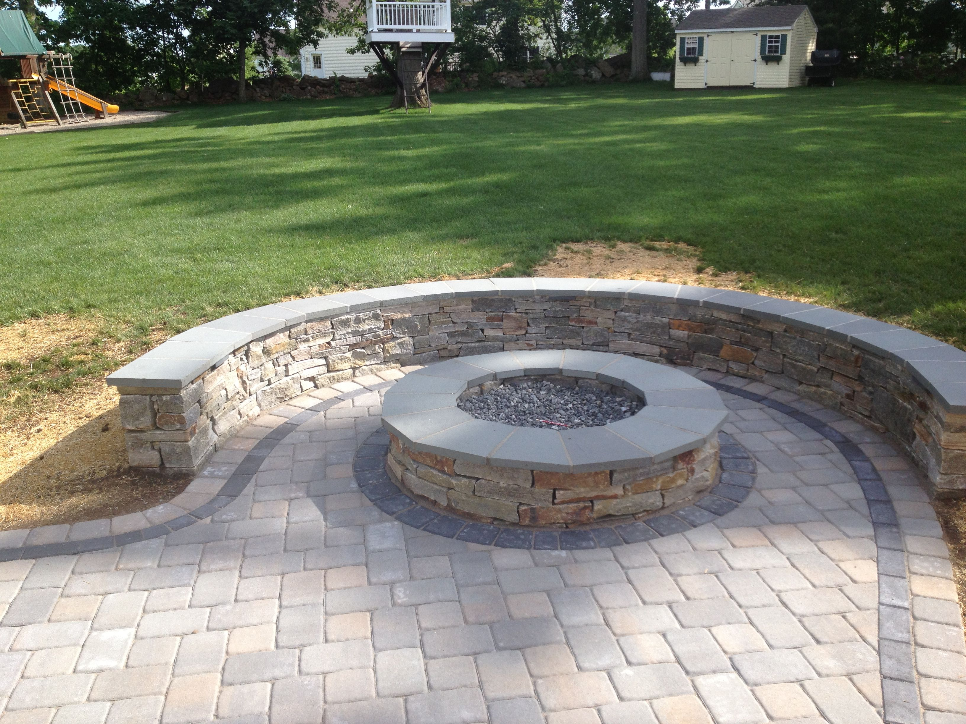 paver patio with fire pit design ideas Natural Stone sitting wall with bluestone cap surrounds a