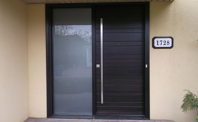 Modern style wooden front door in solid wood with horizontal v-joint