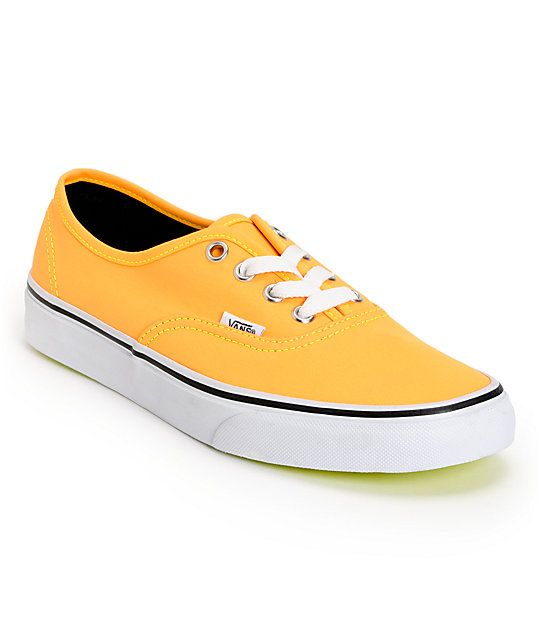 The Vans Authentic girls shoe in the Neon orange and neon yellow colorway  has a timeless cb99fa8a7