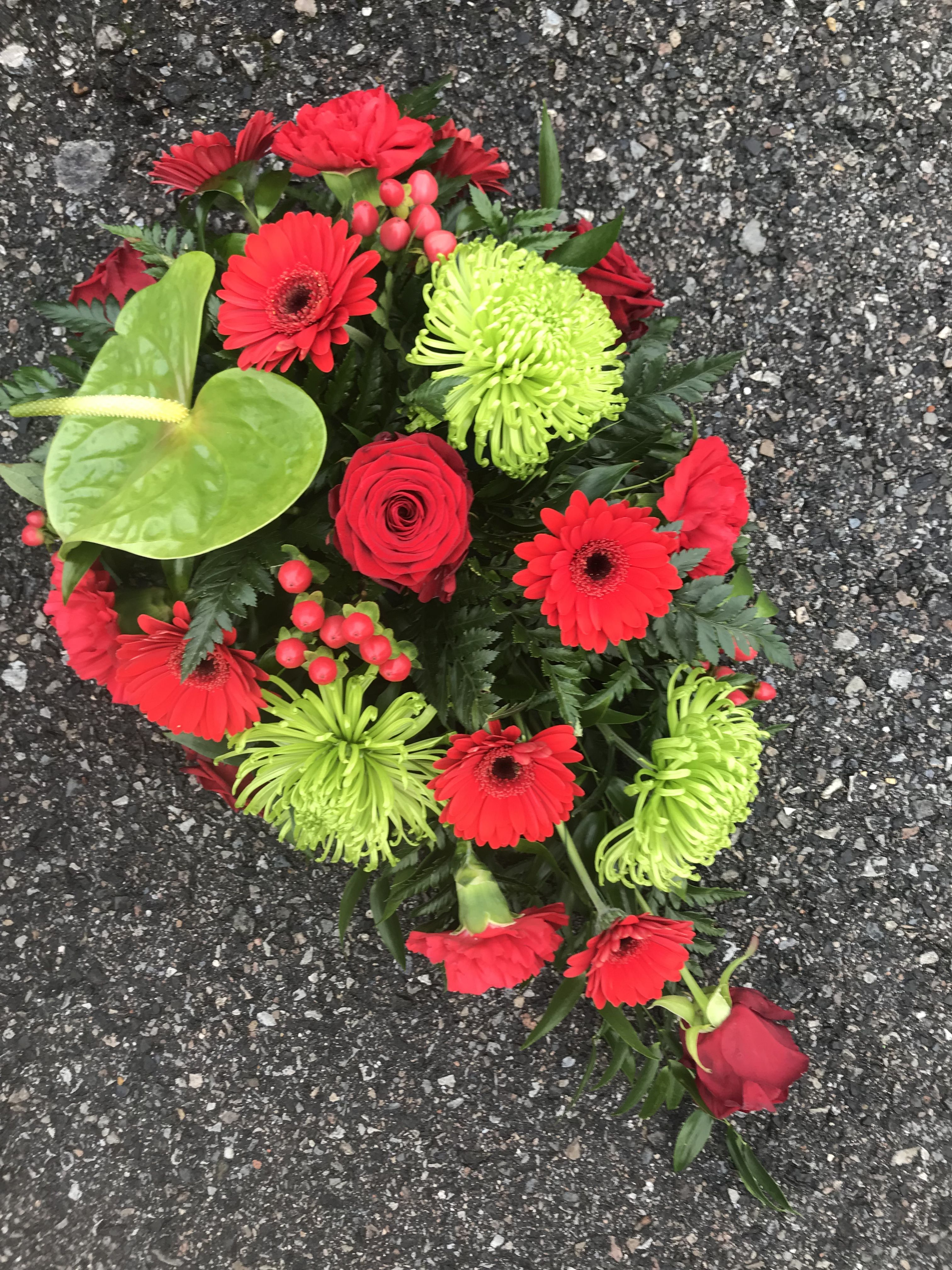 Red and green oasis spray with chrysanthemum blooms anthurium experienced freelance florist working from a private studio in gravesend kent specialising in fresh flower arrangements for funerals and weddings offering izmirmasajfo Gallery